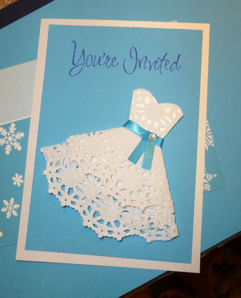 Handmade shower invitations using doilies.