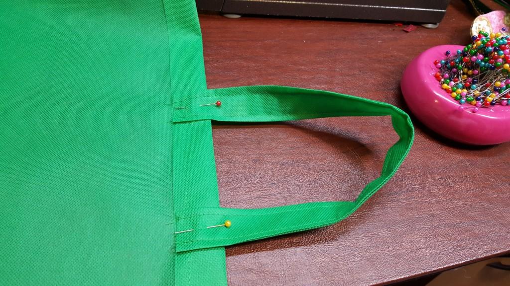 Pin handle to bag