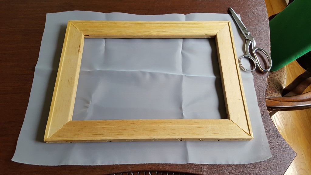 Cut a piece of mesh slightly larger than your frame.