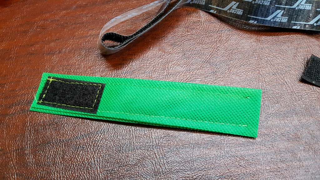 Attach velcro to one end of strap.