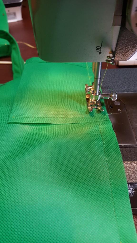 Stitch side seams of bag, including pocket.