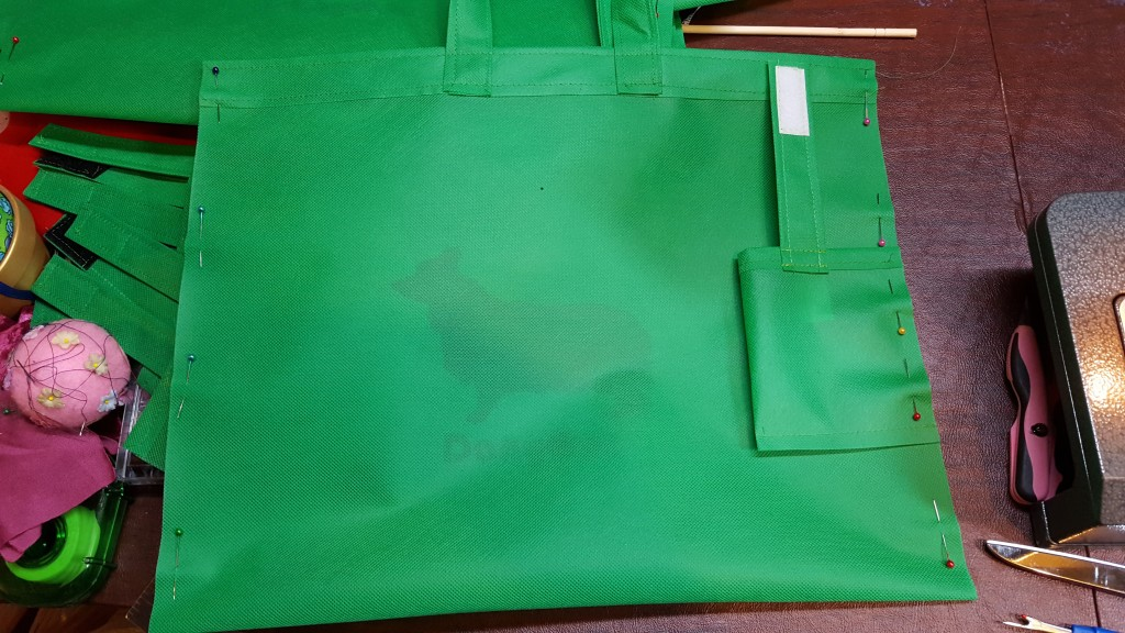 Pin pocket to side seam of bag
