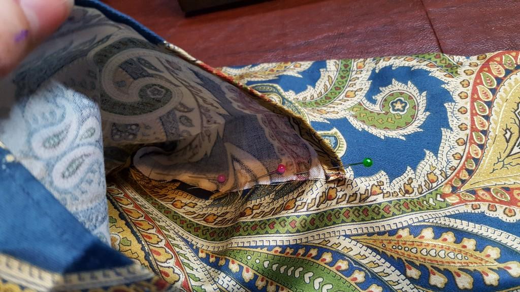 Pin sides of pocket to bag.