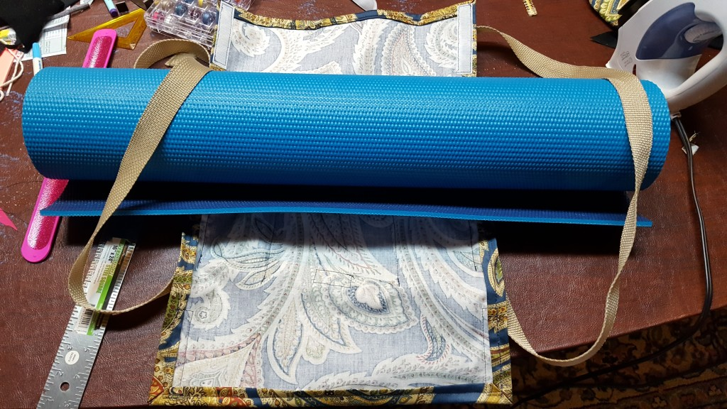 Insert mat through straps