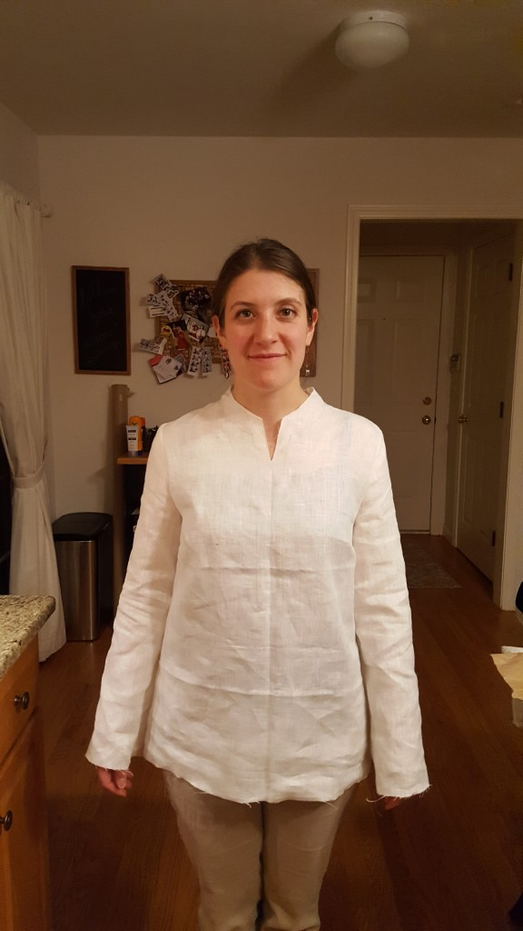 Plain linen tunic without finished collar, sleeves or bottom.