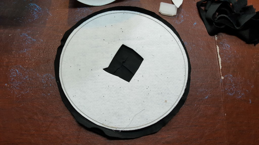 Place interfacing on brim pieces and turn right side out, sandwiching the interfacing inside.