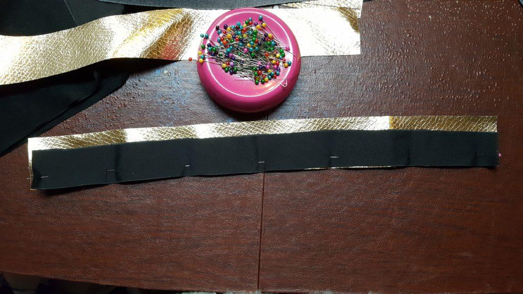 Pin black to gold stripe.