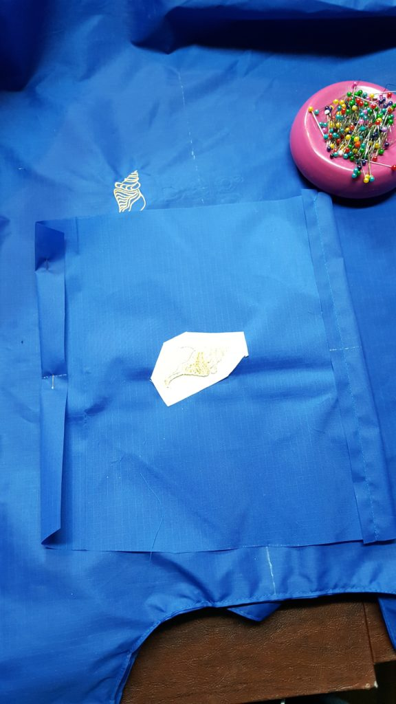 """Fold under 1/2"""" on top of pocket and stitch."""