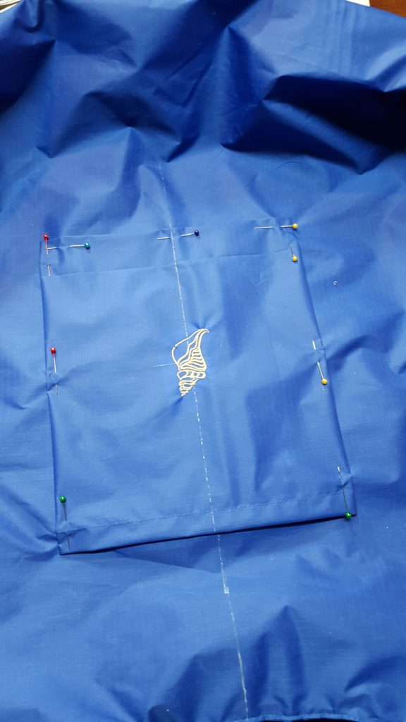 """Fold under edges 1/2"""". Pin pocket to center back of bag. Top stitch around edges."""