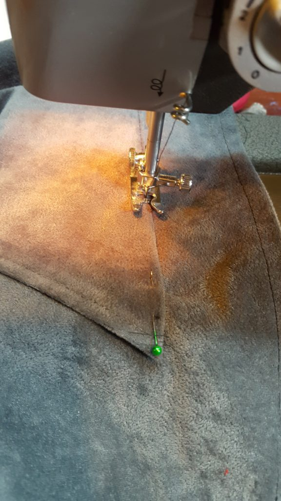 Stitch on the right side of the pocket.