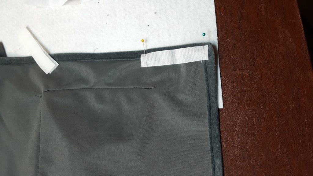Attach velcro to sides inside carrier.
