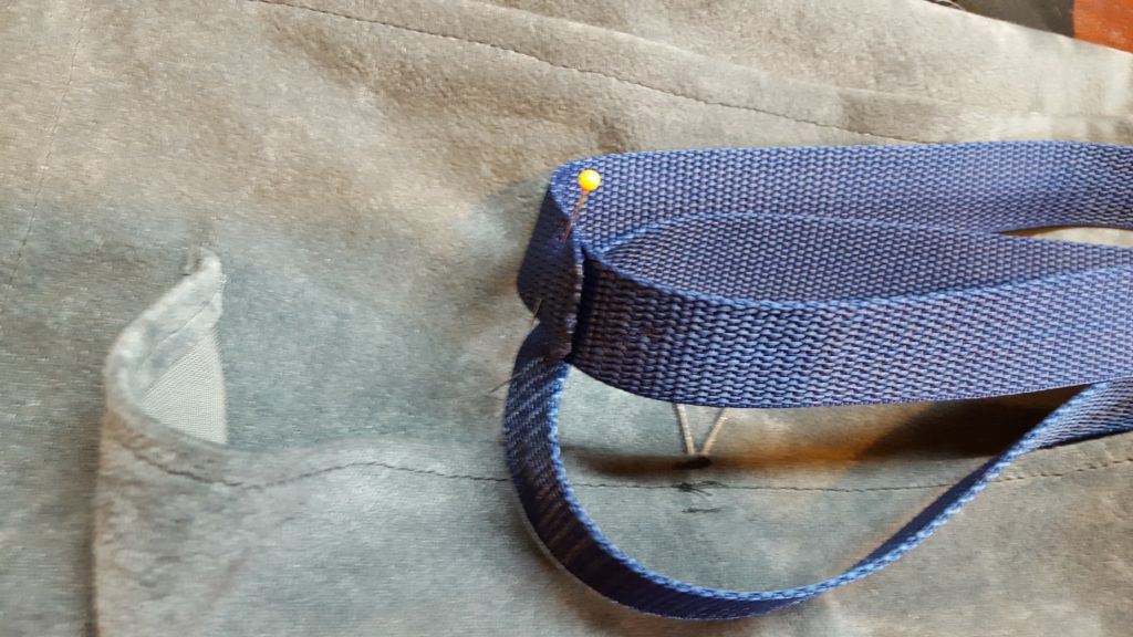 Stitch nylon together. Fold loop in half, and mark the center on both sides.